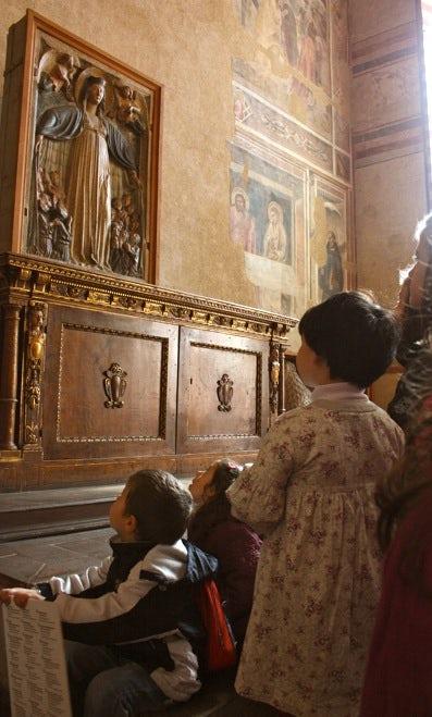 Scene in church at Santo Spirito at Florence, Tuscany