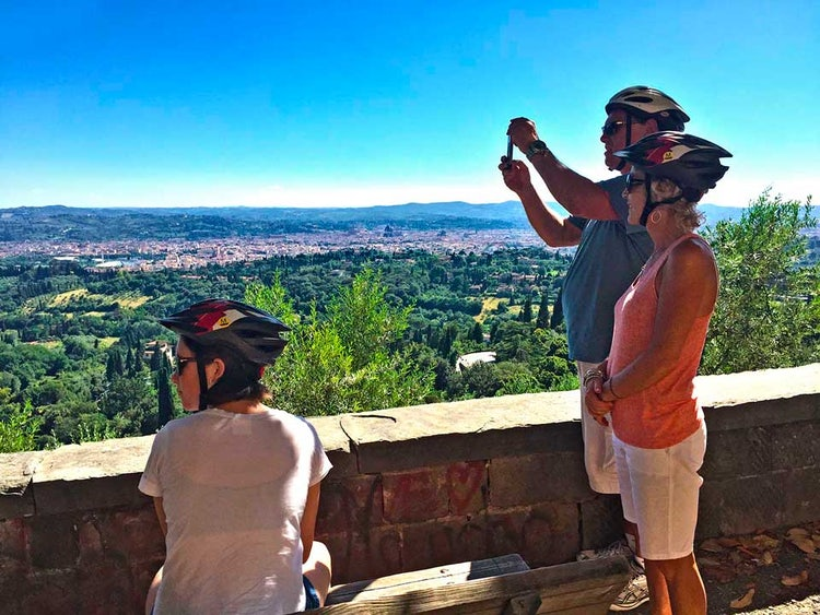 Family adventure tours from Florence, sliding downhill on a biking tour