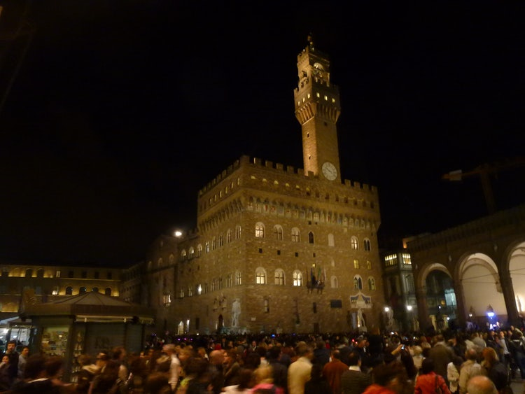 The Tower lite at night in Piazza Signoria