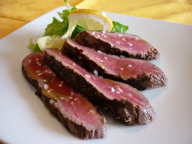 Extra virgin olive oil and the tagliata beef steak