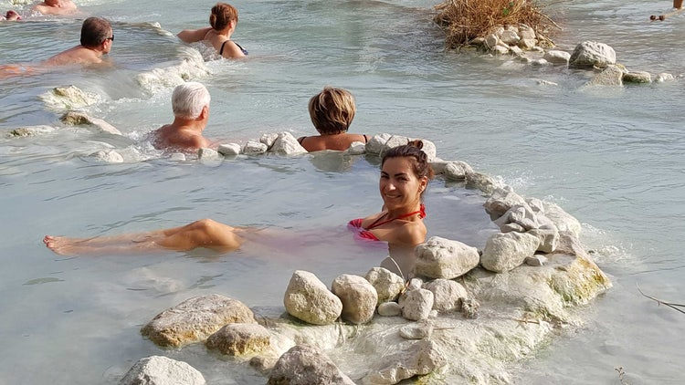 Finding a quiet spot in Saturnia hot springs in Maremma Tuscany