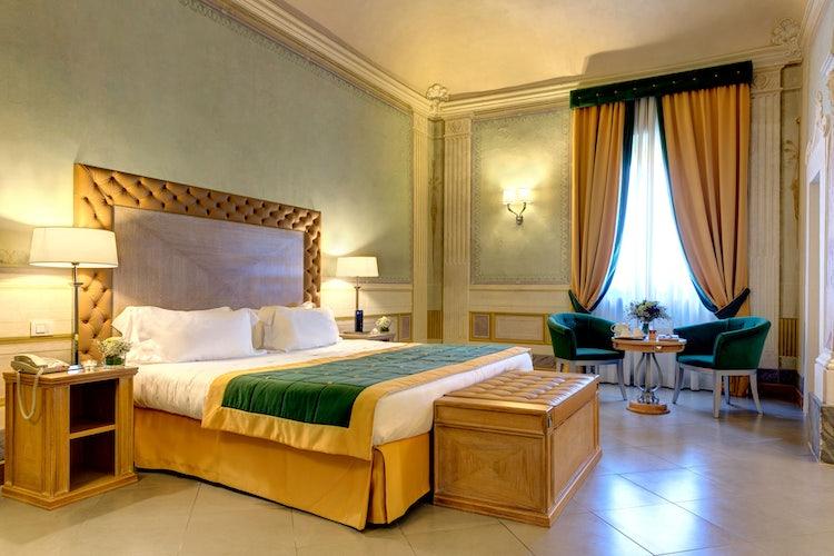 Deluxe bedroom at Villa Tolomei